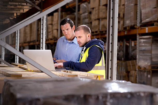 warehouse manager checks something with his supervisor